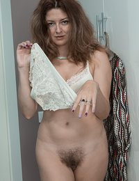 Elena V tries on her blue dress and looks sexy in it. It comes off with her lingerie and stockings and she shows her natural body off. Her hairy pits and pussy amaze us, and she shows it off for us all.